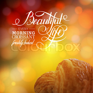 Vintage lettering. Croissant and bokeh backdrop.