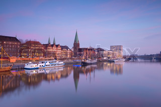 Bremen city by river at sunset