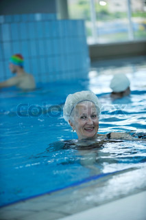 Beautiful old senior woman have fun and recreation on swimming pool stock photo colourbox for Female only swimming pool london