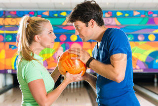 Young people playing bowling and having fun
