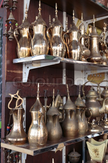 Eastern metal jugs in the shop Arab