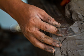 Hands of potter in clay