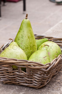 Fresh ripe pears in a wicker basket