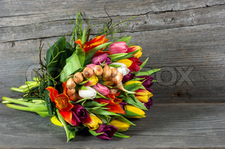 spring tulip flowers over rustic wooden background