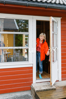Woman looking out of a cabin door