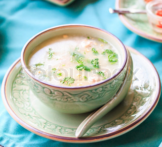 Asian style breakfast soft boiled rice, rice soup Thailand food