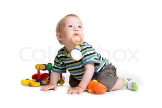 Child with a toy in the mouth