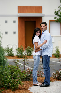 Young couple in front of apartments