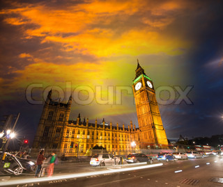 Night sky and traffic in Westminster area - London. Houses of Parliament with city lights