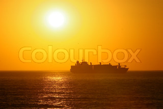 Image of 'sunset, sun, tanker'