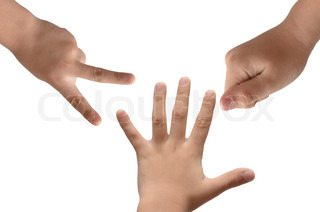 Closeup of little kid hands sign rock paper and scissors on white background