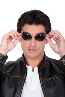 handsome man wearing leather jacket and sunglasses