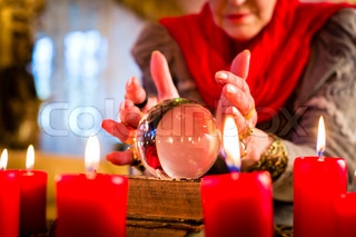 Soothsayer during esoteric session with Crystal ball