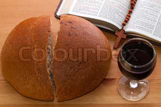 Communion, bread, wine and Bible on the table