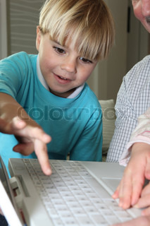 Boy learning computer skills