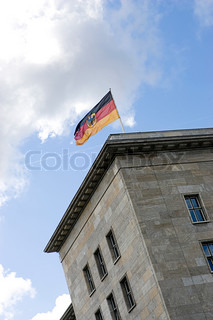 German flag hoisted on top of a building