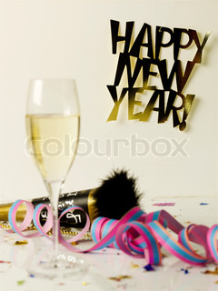 Champagne and confettis for new year's party