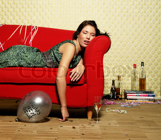 A woman sleeping on a sofa after a night of celebration
