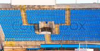 Empty rows of seats at football stadium