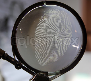 Fingerprint in a larger glass