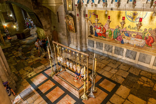 Stone of Anointing inside The Holy Sepulcher Church.