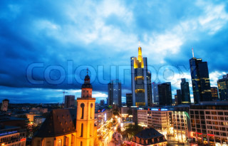 FRANKFURT - NOV 1: City architecture at evening on November 1, 2013 in Frankfurt. The city welcomes more than 4 million tourists every year
