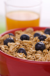 Bowl of Granola and Boysenberries and Juice