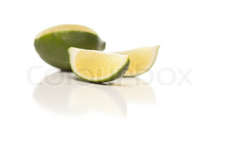 Sliced Lime on Reflective White Surface