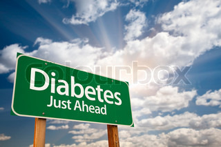 Diabetes Just Ahead Green Road Sign and Clouds