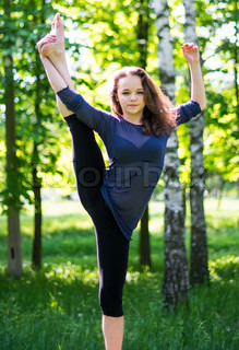 Gymnast girl on nature in spring