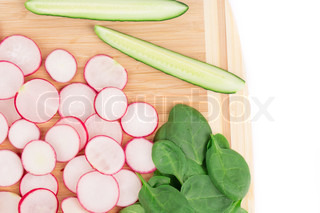 Wooden platter with vegetables.