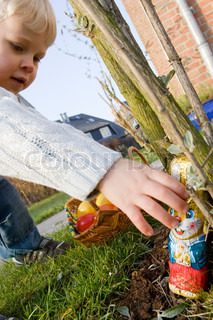 A caucasian boy on Easter hunt