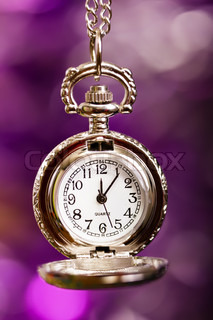 silver retro clock on a festive purple background
