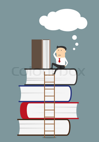 Businessman sitting and reading books